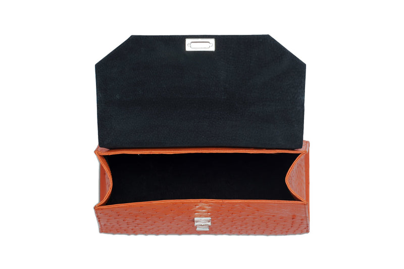 Open top view ostrich leather constructed top flap handbag turn lock. Top handle, adjustable detachable shoulder strap with snap hooks. High quality black leather interior. Inside zip pocket with internal patch pocket. High quality suede leather lining. Bottom bag feet studs.