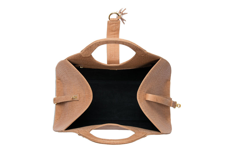 Open top view Leather bag with fold over hidden magnet strap with D-ring & tassel decoration for closure. Attached round shaped handles decorated with two studs. Internal zip pocket with two internal patch pockets. Black high quality leather lining.  Bag feet.