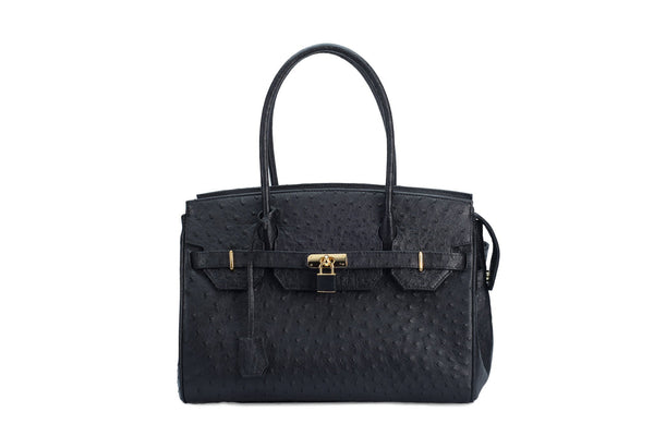 Ostrich leather handbag with top zip. The interior contains an inside zip pocket with two internal patch pockets, and is lined with high quality black suede leather. Features a double handle and a gold lock system as decorative hardware. Bag feet studs are located on the bottom panel of the bag.