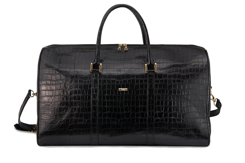Front view embossed Crocodile leather duffel bag. Includes a double zipper and double carry handles. Adjustable and detachable shoulder strap. Black suede leather interior, inside zip pocket and two open pockets.