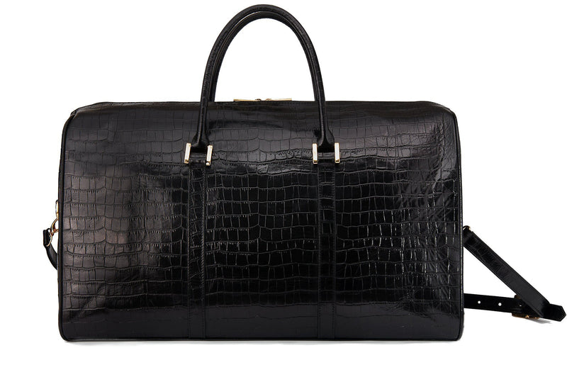 Back view embossed Crocodile leather duffel bag. Includes a double zipper and double carry handles. Adjustable and detachable shoulder strap. Black suede leather interior, inside zip pocket and two open pockets.