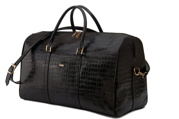 Front side view embossed Crocodile leather duffel bag. Includes a double zipper and double carry handles. Adjustable and detachable shoulder strap. Black suede leather interior, inside zip pocket and two open pockets.