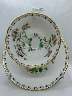 Tuscan China, England.  Cup and Saucer. Floral, Red, Blue, Silver, Yellow