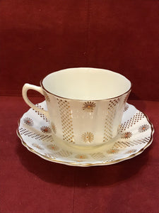 Alesbury, England. Cup and Saucer. White with gold flowers