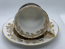 Load image into Gallery viewer, Queen's, Staffordshire, England.   White with chocolate Brown and Gold. Demitasse Cup and Saucer