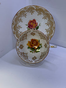 Paragon, England.  Cup and Saucer.  Large Yellow /Pink Rose, Gold Decoration