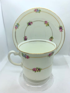 England.  Made in England.  Cup and Saucer.  Pink/Yellow/Mauve and Blue Flowers