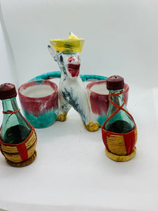 Salt and Pepper. Italy. Dokey with Wine Bottles