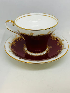 Aynsley, England. Cup and Saucer. Deep Cherry Red with white and gold