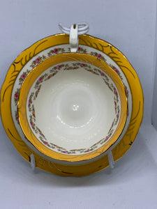 Aynsley, England. Cup and Saucer.  Mustard Yellow/mixed floral