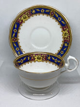 Load image into Gallery viewer, Royal Albert Crown China. England. Cup and Saucer. Cobalt Blue/Purple/Gold with Yellow Flower