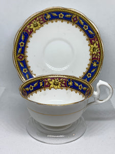 Royal Albert Crown China. England. Cup and Saucer. Cobalt Blue/Purple/Gold with Yellow Flower