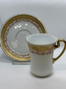 Royal Bayreuth, Germany.  Pink and White flowers, Gold decorative band. Demitasse Cup and Saucer