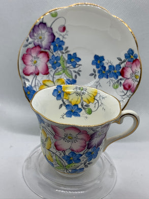 Taylor and Kent, England.  Mauve, pink, blue & yellow. Demitasse Cup and Saucer