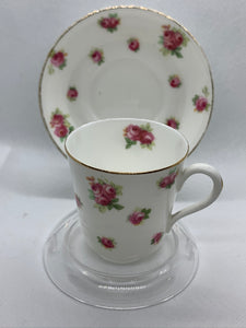 Royal Doulton, England.   Pink Roses/ Gold Trim. Demitasse Cup and Saucer