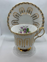Load image into Gallery viewer, Queen Anne, England. Cup ad Saucer.  White with gold roses and purple violets