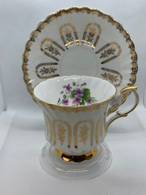 Queen Anne, England. Cup ad Saucer.  White with gold roses and purple violets
