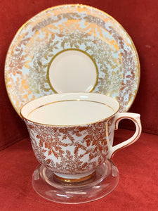 Colclough, England. Cup and Saucer. Gold Chintz. Pastel Blue.