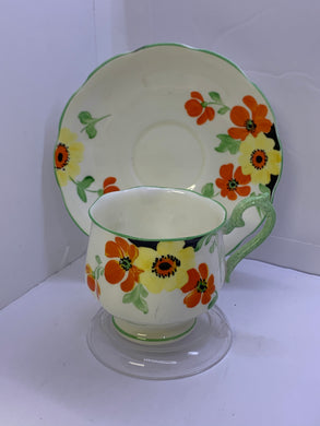 Rroyal Albert-Crown China. England. Cup and Saucer. Art Deco- Yellow and Orange Flowers