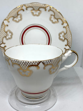 Regency, England. Cup and Saucer. Gold trellis and flowers with red band