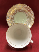 Load image into Gallery viewer, Colclough, England.  Cup and Saucer.  Gold Chintz.  Mint Green.