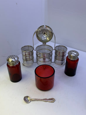 Salt and Pepper. England. Gotham  Sterling Silver with Ruby Glass Inserts.