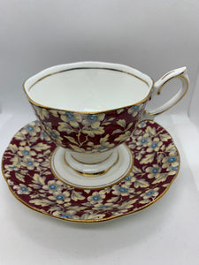 Royal Albert, England. Cup and Saucer. Maroon with white flowers/blue centres