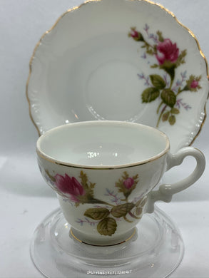 Unmarked, Demitasse Cup and Saucer. Hand painted.  Dark Pink Roses.