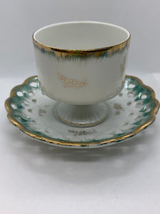 Unmarked.  Demitasse Cup and Saucer.  Lustreware- green