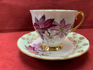 Windsor, England. Cup and Saucer. Large coloured Poinsettias