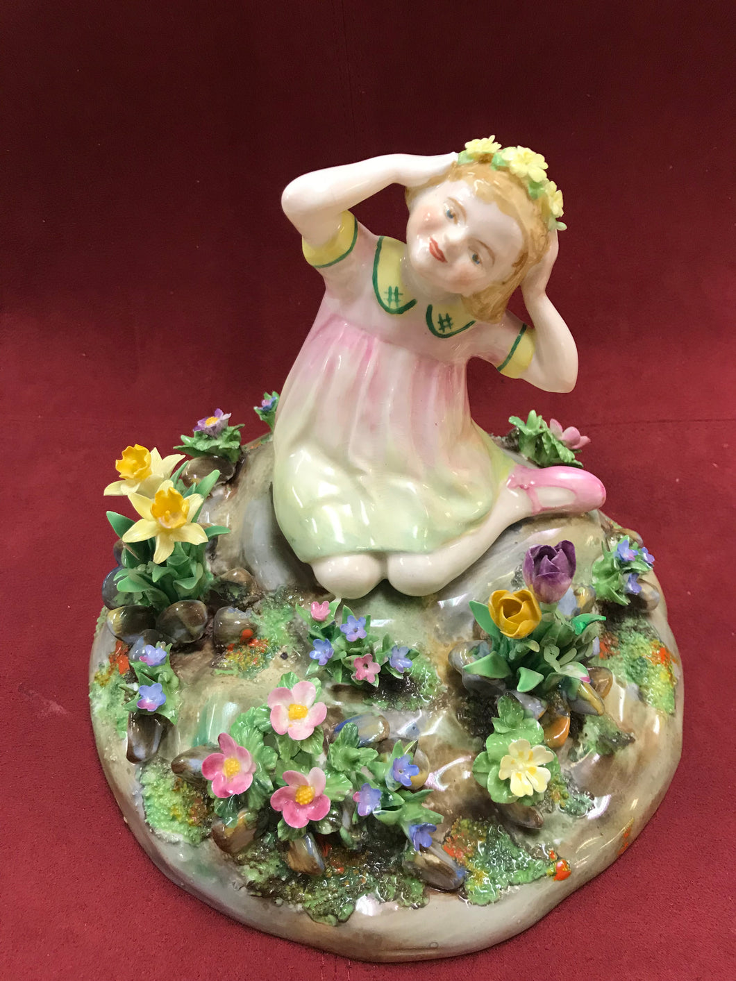 Crown Porcelain, England, Figurine.  Girl Seated with Spring Time Flowers