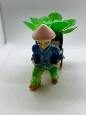 Planter. Japan. Oriental Man pulling cart.