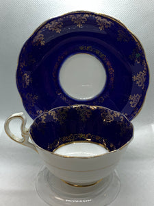 Royal Albert. Crown China. England. Cup and Saucer. Cobalt Blue , Gold hearts and flowers