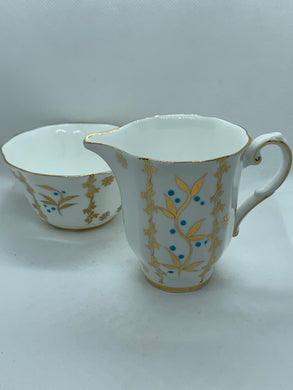 Royal Grafton. England.  Creamer and Sugar.  Gold leaves, Gold Daisies- Dotted with Blue Flowers.