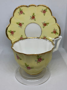 Salisbury, England.  Cup and Saucer.  Buttercup Yellow with Tiny Pink Roses