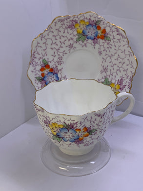 Paragon. England. Cup and Saucer. Blue,Yellow and Orange Flowers