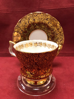 Windsor, England. Cup and Saucer. Burgundy/gold chintz