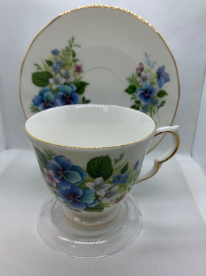 Queen Anne, England.  Cup and Saucer. Blue Flowers