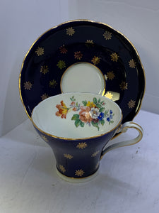 Copy of Aynsley. England. Cup and Saucer.  Cobalt Blue with gold Stars.  Mixed Bouquet
