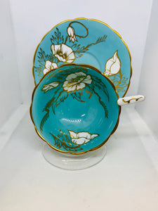 Royal Stafford, England. Cup and Saucer.  Turquoise with White Rose with Gold