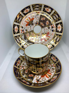 Royal Crown Derby. England. Trio-demitasse cup and saucer with side plate.
