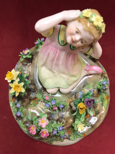 Crown Staffordshire. England. Figurine. Girl seated with Flowers
