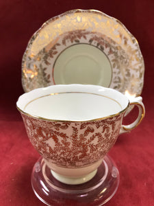 Colclough, England.  Cup and Saucer.  Gold Chintz.  Mint Green.