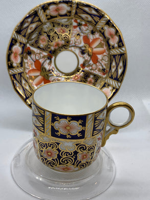 Royal Crown Derby, England. Demitasse Cup and Saucer. Cobalt Blue/Orange/Gold on White.