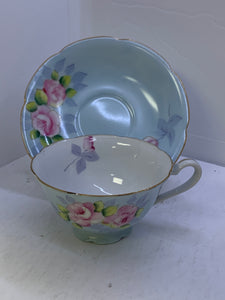 Occupied Japan. Cup and saucer.  PAstel Blue with  Large Pink Roses.