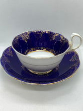 Load image into Gallery viewer, Royal Albert. Crown China. England. Cup and Saucer. Cobalt Blue , Gold hearts and flowers