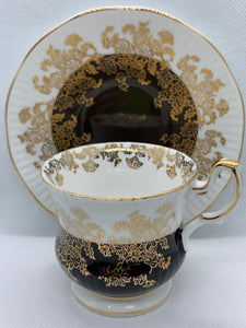 Queen's, Staffordshire, England.   White with chocolate Brown and Gold. Demitasse Cup and Saucer