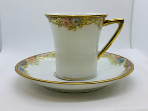 Japan. Demitasse Cup and Saucer. Pink and Blue Roses with Gold trim
