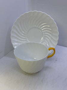 Aynsley. England. Cup and Saucer. White Swirl with Yellow Handle
