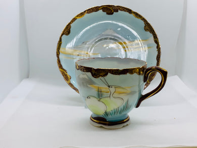 Unmarked. Demitasse Cup and Saucer. Mt. Fugi with Lake and Birds.